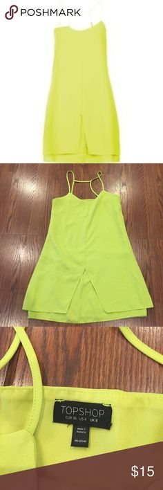 TOPSHOP Party Dress This bright beauty will make you stand out in any crowd! Lime green/neon yellow spaghetti strap mini dress with a double layer on the bottom. Lightly used! Topshop Dresses Mini