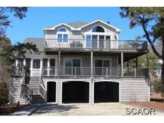Rent an impressive ocean block coastal home with inverted floor plan including family room, sunroom, stunning kitchen off the great room. Large wrap around porch surrounded by mature landscaping along a lovely stretch of beach close to town. All the space needed for relaxing in the sun & sand. Call Crowley at 1800-732-7433 or Visit Crowleyrealestate.com for full details and rental availability.