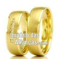 Alianças em ouro casamento 18k Largura 5.5mm Pedras 7 diamantes de 1 ponto Acabamento Fosco e Liso Formato Anatômico Peso 10.5gramas o par