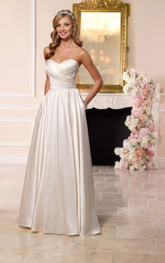 Luxe satin twists and turns to flatter the figure in this strapless A-line designer wedding gown from Stella York. Perfect for an evening wedding celebration!