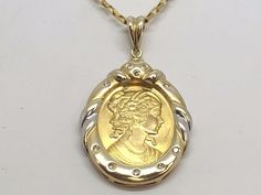 14K YELLOW GOLD .999 CAMEO COIN PENDANT .13CT DIAMONDS, SI2, H  COLOR