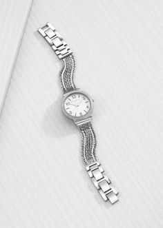 This is the beautifully handcrafted Superior Details Watch by Silpada. It's a Sterling Silver timepiece. You can remove the links yourself.  It comes with a lifetime warranty. Contact me to order this beauty.