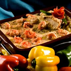 Moqueca is a Brazilian stew based in a coconut milk, tomatoes, onions, garlic and coriander slowly cooked in a terra cotta pan optionally serves with prawns, fish, crabs, or lobsters.