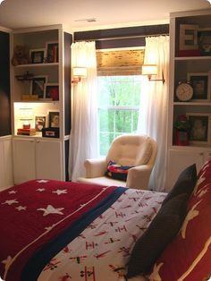 Imagine built-ins around master bedroom window... closets on top, drawers on bottom.  I like the chair in the middle - it's cozy.