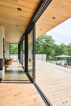 In this contemporary Canadian home, both the living room and the kitchen have access to the deck outside, making it easy to enjoy indoor/outdoor living during the warmer months.