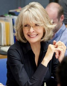 There we go!  I DON'T have to go short and matronly in a few years:  Short Haircuts for Women Over 50: Diane Keaton Hairstyle