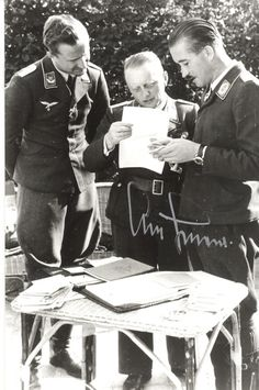 Adolf Galland discussing with others