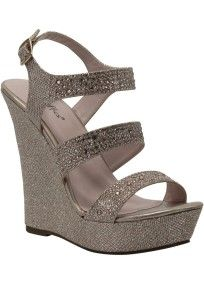 "This everyday on trend wedge will become a staple in any closet!  Open toe wedge sandal features dazzling glitter fabric embellished with rhinestones along straps.  Ankle strap with adjustable buckle ensures a comfortable fit.  Heel measures 5 1/4. Platform measures1 1/2"".  Manmade cushioned sole.  Fully lined. Imported by Coloriffics."