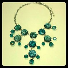 Statement Necklaces This beautiful silver tone and blue-green sparkling statement necklace measures at 16 inches long with an additional 3 inch extender to make 19 inches total. it could be worn as a choker or could be worn lower down depending on the blouse or shirt that your matching it too. this would definitely dress up any top! A great piece of costume jewelry. Jewelry Necklaces