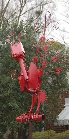 A large red steel scrap bird I made for a client.