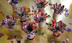 Small coloured pieces of paper on paper rols make wonderful flowers