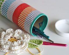 Tube covered in paper tape to store crochet hooks