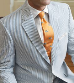 with orange tie