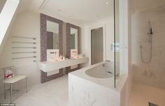 One of the double bathrooms in the house has a deep marble bath, his and her's sinks and a...