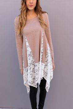A solid tunic top featuring bottom lace detailing throughout. Long sleeves. Knit. Lightweight.