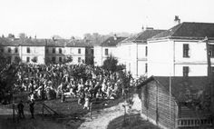 Jews gathered for deportation; near the train station in Bochnia, Poland, September 1942.
