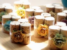 Charmingly sweet wine cork, floral embellished place card holdings.   Reason to hoard wine corks
