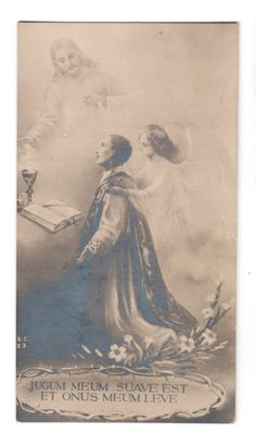 the card says 'My yoke is easy and My burden light' (it is from the vesting Prayers  , that priests used to, and still are supposed to say. Putting on the Chasuble:    Domine, qui dixisti: Jugum meum suave est, et onus meum leve: fac, ut illud portare sic valeam, quod possim consequi tuam gratiam.    'O Lord, Who said: My yoke is easy and My burden light: grant that I may bear it well and follow after You with thanksgiving.'