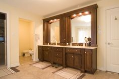 Custom designed vanity for two. Water closet with toilet and bidet.