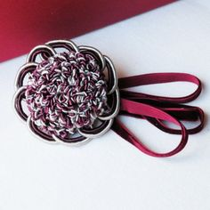 Brooch White and wine color rosette $32.00