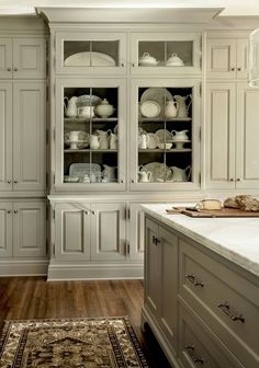 Love the grey cabinets! And those  wood floors!