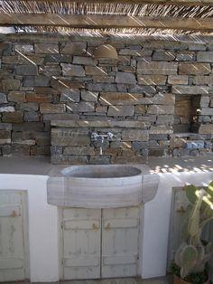 Aged marble sink in an open air kitchen. Paros, Greece
