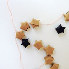 · · lucky star necklace   garland with black paper, kraft paper & knotted linen thread