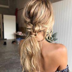 loose braided low ponytail