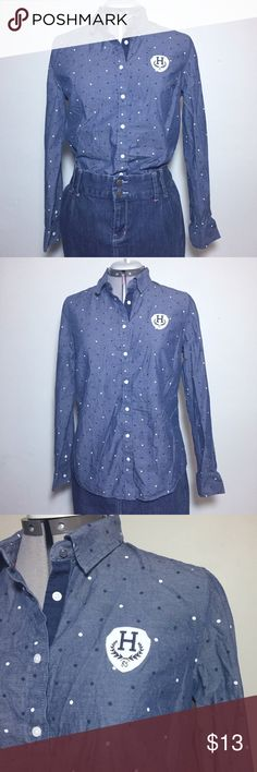 """Tommy Hilfiger Chambray Polka Dot Button Down Top Tommy Hilfiger Chambray Polka Dot Long Sleeve Button Down Top Blouse. It is a classic fit with a patch on front. Size L measures flat approximately: 16"""" across shoulders, 20"""" across chest, 18"""" across Waist, 26"""" long, 24"""" Sleeve. 100% cotton. 1211/50/012518 *Item for sale is in title, other items shown for styling purposes may also be for sale separately* casual Friday weekend wear great with a blazer Tommy Hilfiger Tops Button Down Shirts"""