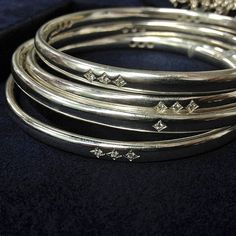 One is nice, a stack is even better! Heirloom by Doyle & Doyle sterling silver bangle bracelets, set with diamonds.
