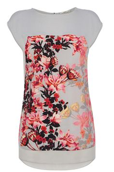 Transforming T-shirts across the nation, we have added a sheer curved hem and pretty floral print to this one to make it that go-to piece for all of your upcoming events, whether you dress it down with jeans or up with an elegant skirt.