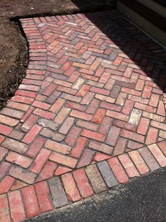 Extend a driveway or path with a brick border or flank.