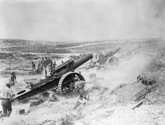 BATTLE SOMME 1 JULY - 18 NOVEMBER 1916 (Q 5817)   Three 8-inch howitzers of 39th Siege Battery, Royal Garrison Artillery (RGA), firing from the Fricourt-Mametz Valley during the Battle of the Somme, August 1916.