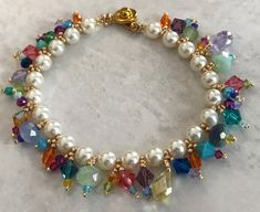 Dancing Crystals Sunday, May 13, 12:30-3:00 p.m. Join us on Mother's Day!Learn to make a sparkling crystal & pearl bracelet.Learn how to string & attach crystal danglesbetween a lovely pearl bracelet.Skill Level: Any. Class Fee: $22, Materials Not Included.