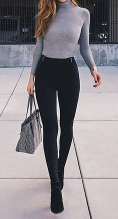 Cute figure-flattering turtleneck. Love the design of the pockets on the slacks. Simple, sexy.