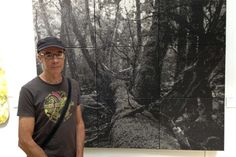 Nigel Hewitt used wood ash from the Dunalley bushfires on the Tasman Peninsula in 2013 to depict a forest in northern Tasmania. The work has won this year's Glover art prize. (Image: ABC/Damien McIntyre)