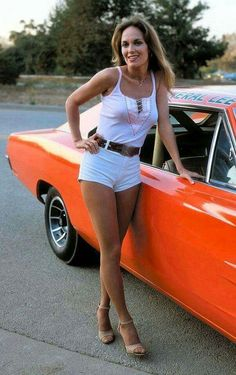 "Here's leggy Catherine Bach in those world famous Daisy Dukes posing next to Dodge Charger supercar ""The General Lee"". Catherine Bach, Dukes Of Hazard, General Lee Car, Pt Cruiser, Ford, Daisy Dukes, Us Cars, Car Girls, Dodge Charger"