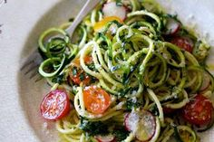 """This """"spaghetti"""" is made from zucchini, extruded through a vegetable spiraliser into long, curling strands of raw vegetable goodness. The garlic, lemon and parmesan really make it feel, and taste, like pasta."""