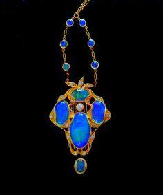 Art nouveau pendant - opals and diamonds set in gold.