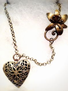 Queen of Love and Beauty Essential Oil Diffusing Necklace by OverYourHeart, $18.00