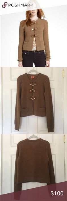 Tory Burch Ross Buckle Cardigan (brown wool) $350 Tory Burch Ross Buckle Cardigan Wool Sz M. Lightly worn. Rugged meets refined in the Ross Cardigan. Its cropped silhouette has a jacket-like feel thanks to a trio of gold-trimmed leather clasps at the front. A richly textured knit, this layer lends a laidback, ladylike polish to all your looks. Tory Burch Sweaters Cardigans