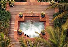 wouldn't be a dream home without an outdoor jacuzzi