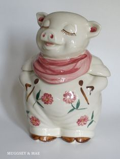 My mother in-law has one just like this except it is a boy. Here is his wife ;) Shawnee Spring Flower Smiley Pig Cookie Jar by muggseyandmae, $220.00