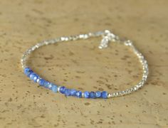 Bracelet made with Kyanite beads and sterling silver beads  Sterling silver clasp   if you like the other bracelet on the picture of the wrist please go to:  https://www.etsy.com/listing/126259238/tiny-sterling-silver-beads-bracelet?ref=shop_home_active_35   Shipping: After order is placed, bracelet will be made and sent after 5 Business Days (Mon-Fri) via Postal Service First Class (no tracking). If you need tracking or insured please check shipping options when you purchase  Thanks for…