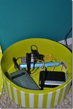 Hide electronic cables/modems in a hat box. LOVE!