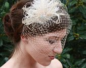 As Seen in Polka Dot Bride Champagne Birdcage Veil with Ostrich Feather Wedding Fascinator. $85.00, via Etsy.