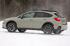 February 2013: The Subaru XV Crosstrek Limited. we have a 2014 in same color khaki.