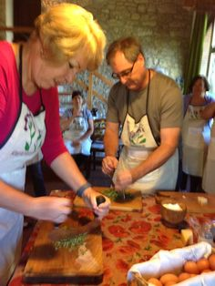 Chopping our veggies during our Italian Cooking class in Tuscany using mezzaluna