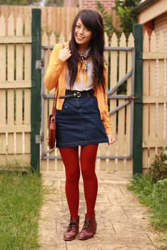 Love this color scheme for a denim skirt -- dark red tights and a yellow cardi
