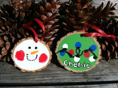 More thumbprint Christmas ornaments we made on wood slices. Wood slices can be found for sale at our shop www.etsy.com/shop/lightofdaycreations